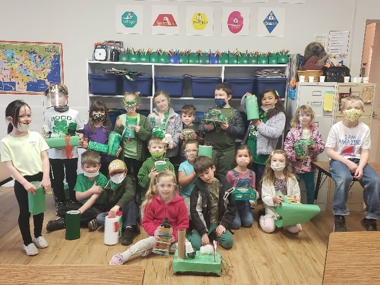 Kindergarten students displaying their leprechaun traps.
